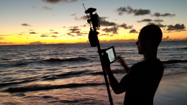 Christopher Kahn uses Arrow Gold GNSS (base and rover) to map construction assets on a remote island at sunset