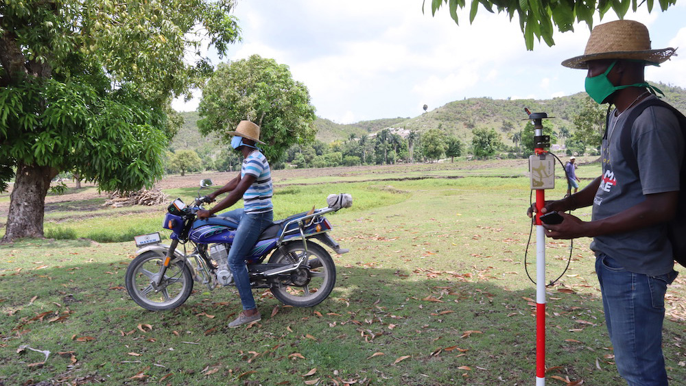 Josiah Thomas and a team mate, of ADF Haiti, use an Arrow Gold GNSS receiver, ArcGIS apps, and Atlas correctional service to map agriculture assets in Haiti