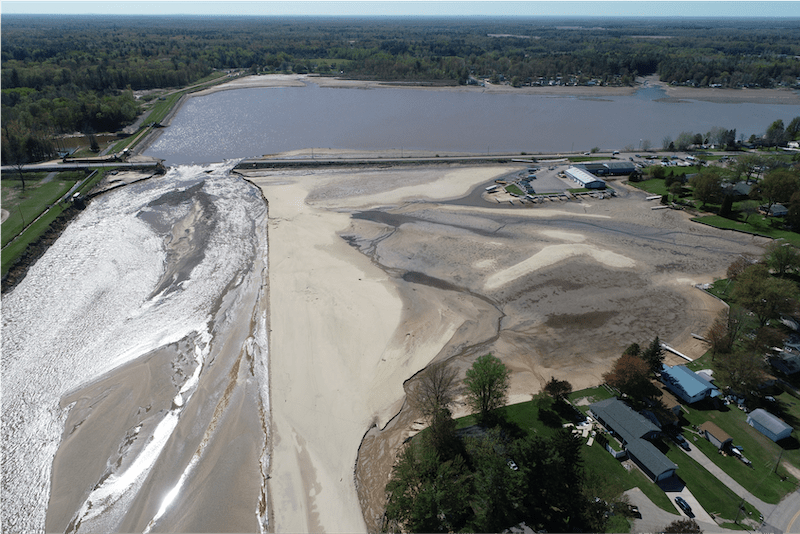 Aerial imagery shows the M30 causeway bridge completely destroyed by the flooding.