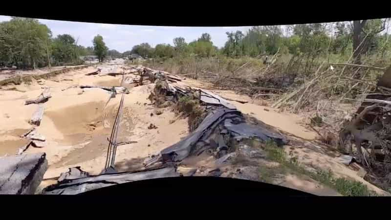 Damage from the flood shows debris from neighboring ballparks that leveled a road and toppled trees.