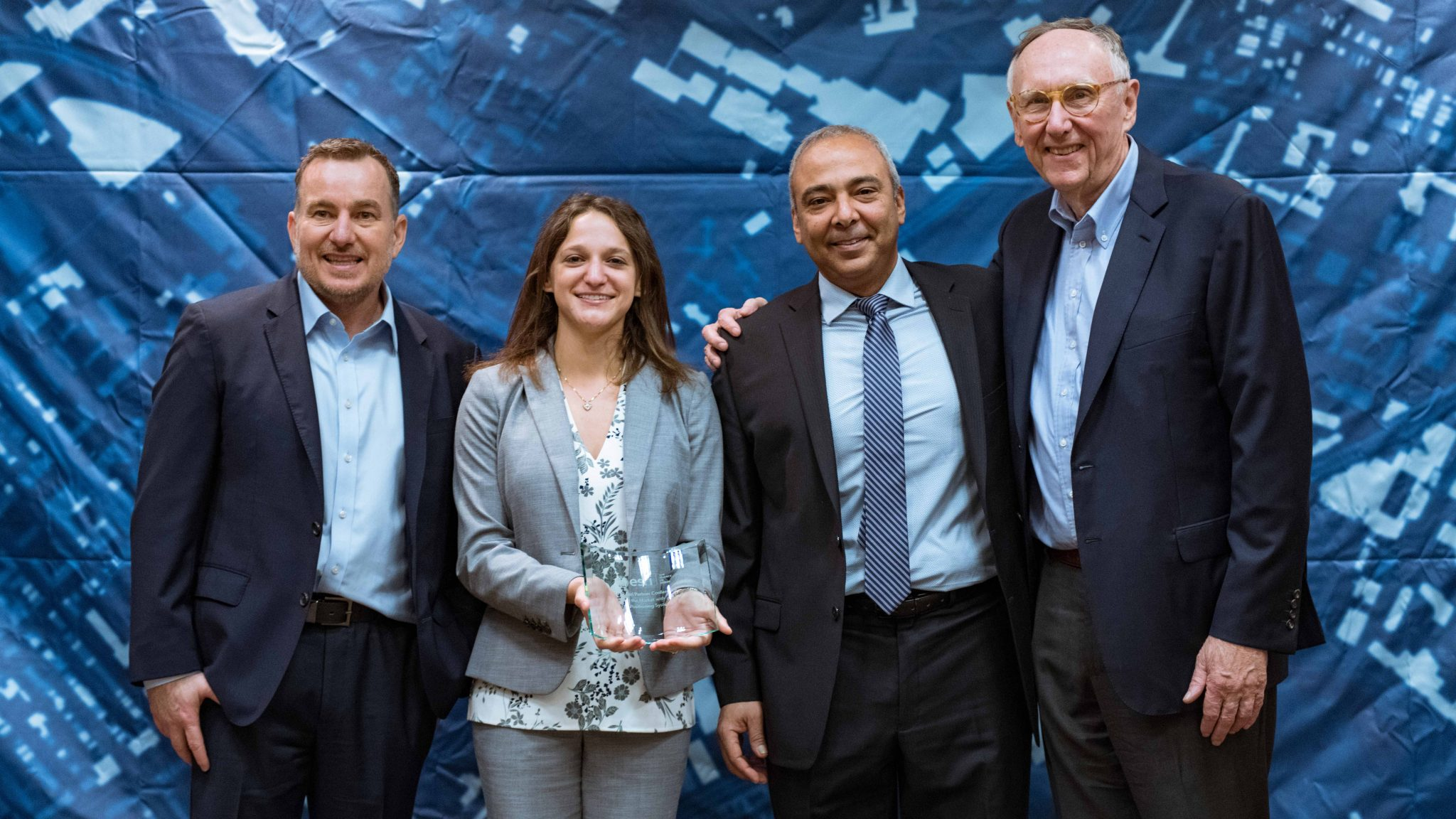 Left to Right: Esri Director of Global Business Development Jeff Peters, Eos Director of Marketing Sarah Alban, Eos CTO Jean-Yves Lauture, Esri President Jack Dangermond