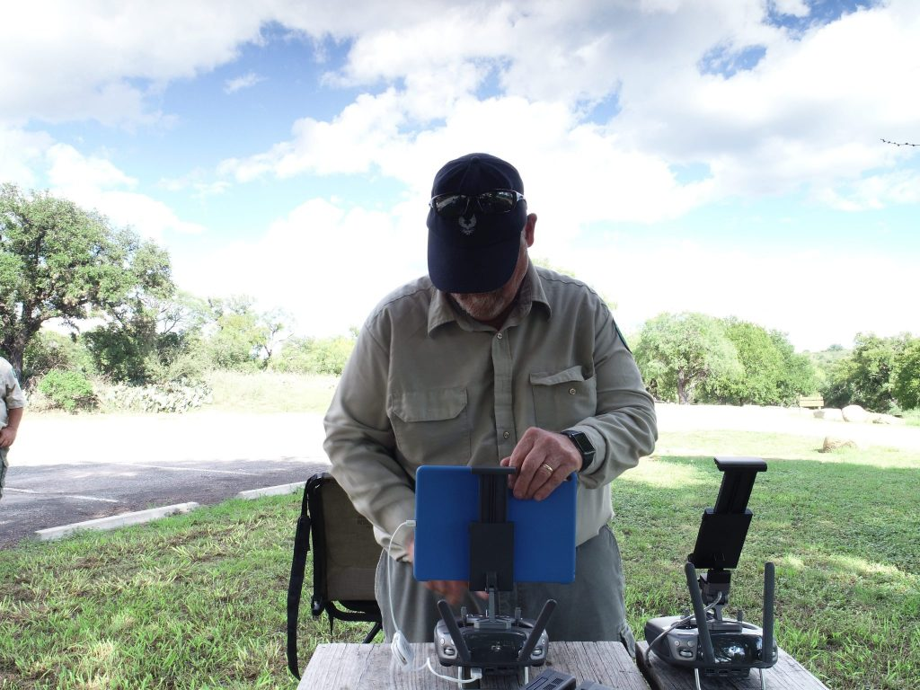 FIELD PHOTO - CASE STUDY - RAPTOR AERIAL SERVICES - Michael Allison, Mission Control, DJI Drone, iPad; Setting Ground Control Points (GCP)