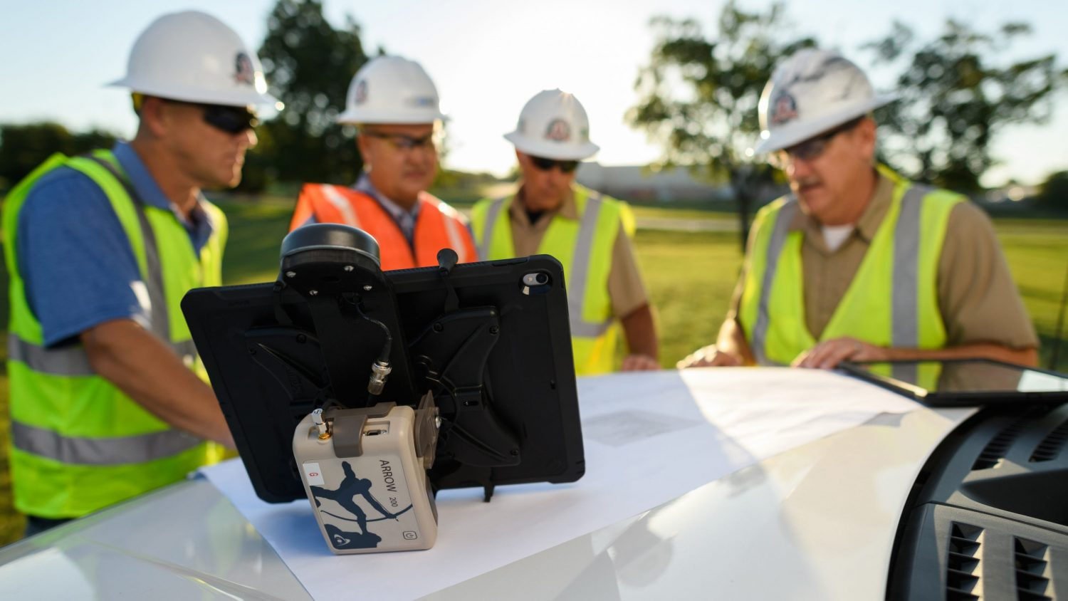 A Tri-County Electric Cooperative crew checks their data in the field, photo courtesy of Kevin Brown