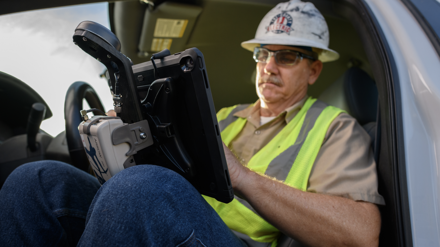 A Tri-County Electric Cooperative employee checks his GIS utility data in Futura's FieldPro app while out on a staking project in Texas