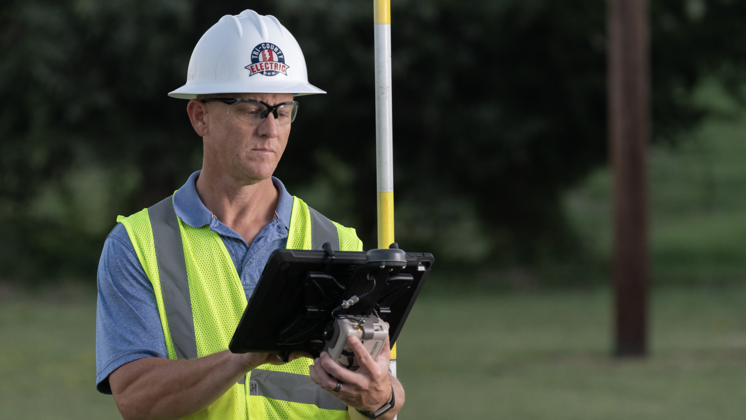 A Tri-County Electric Cooperative employee checks his GIS utility data in Futura's FieldPro app while out on a staking project in the field