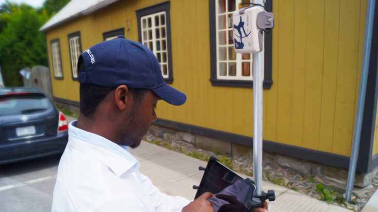 A fieldworker collects municipal utility data using an Arrow 200 GNSS receiver and ArcGIS Collector