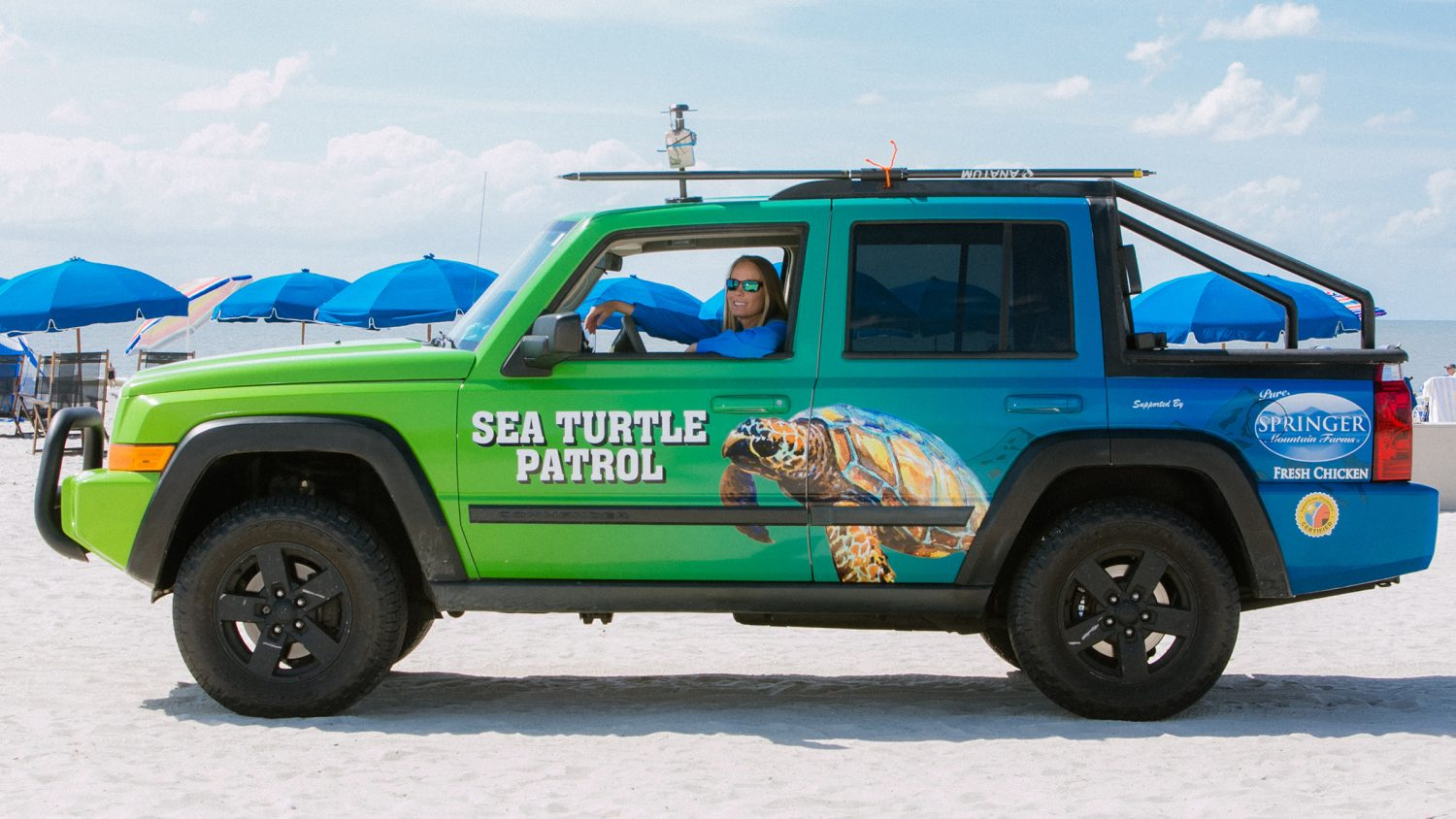 Amber Kuehn shows off her mapping setup with an Arrow Gold GNSS receiver mounted to a voluneer Sea Turtle Patrol Jeep on the Atlantic Coast