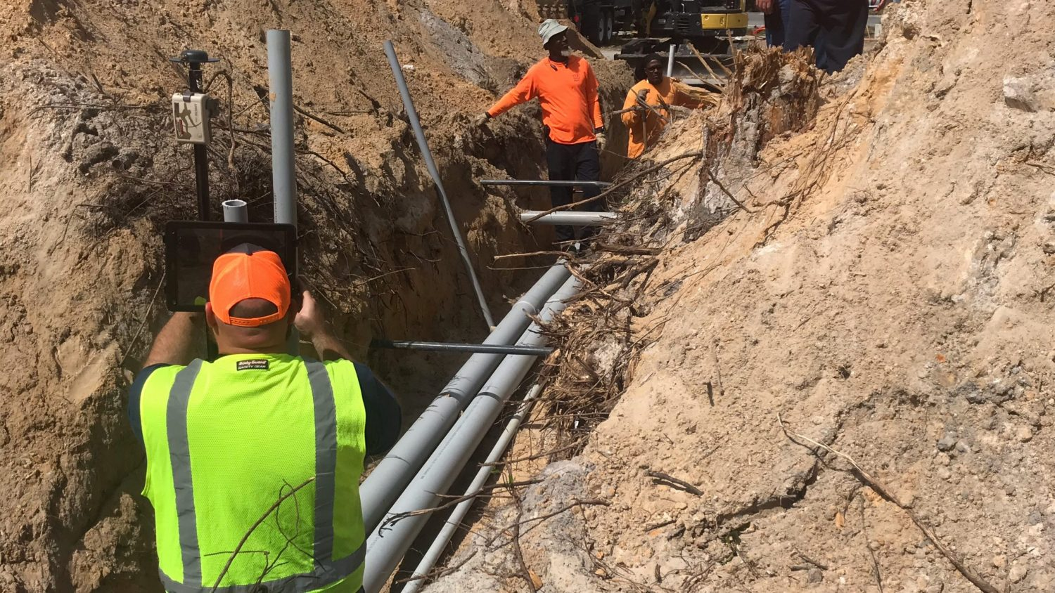 Utility Commission of New Smyrna Beach crew map assets in a trench in Florida