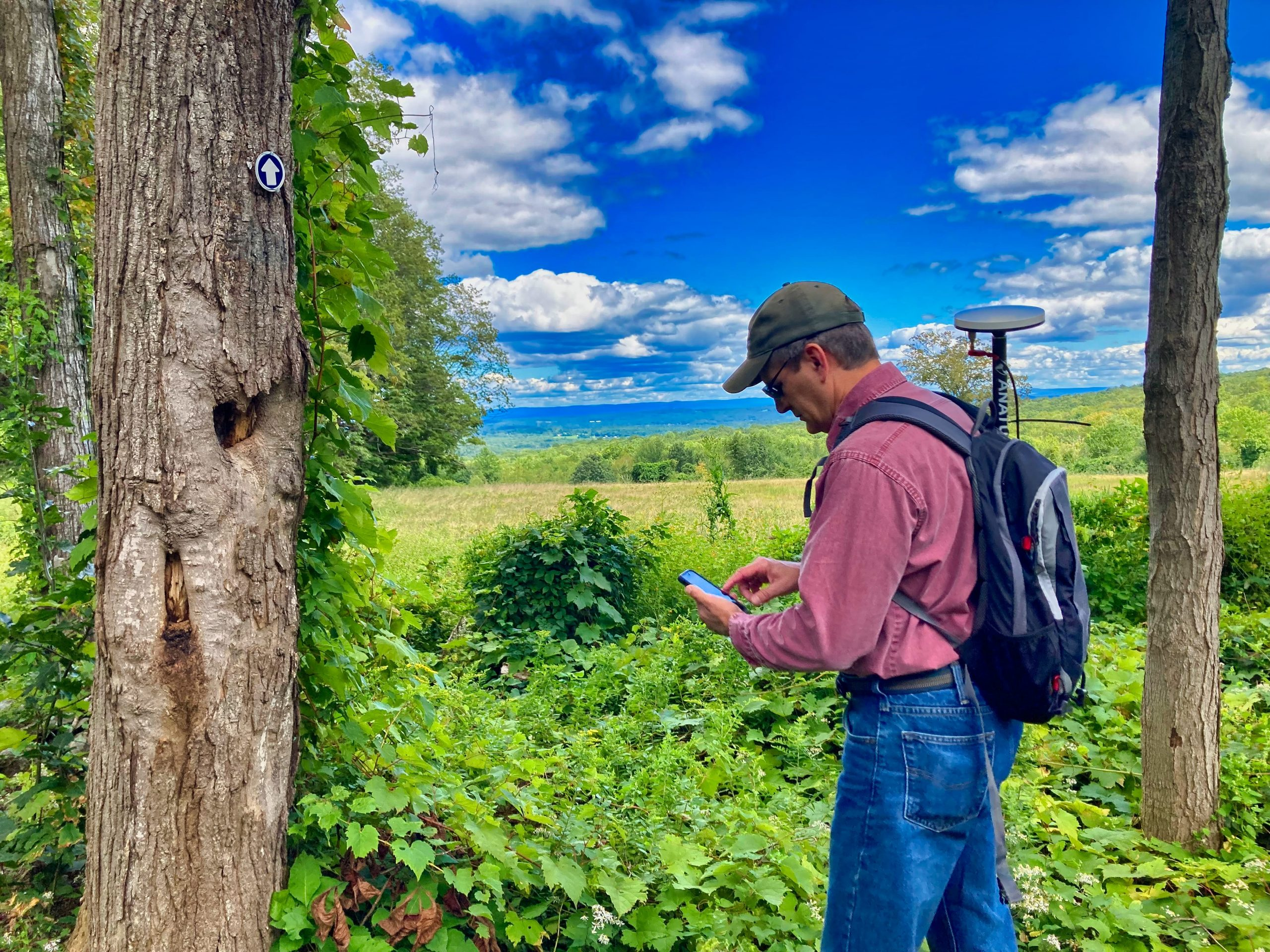 Steve Perry collects high accuracy GNSS GPS data in the field for a land trust conservatorory using Esri ArcGIS Field Maps